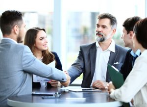 Business people in formal clothes finishing business meeting about logistics software