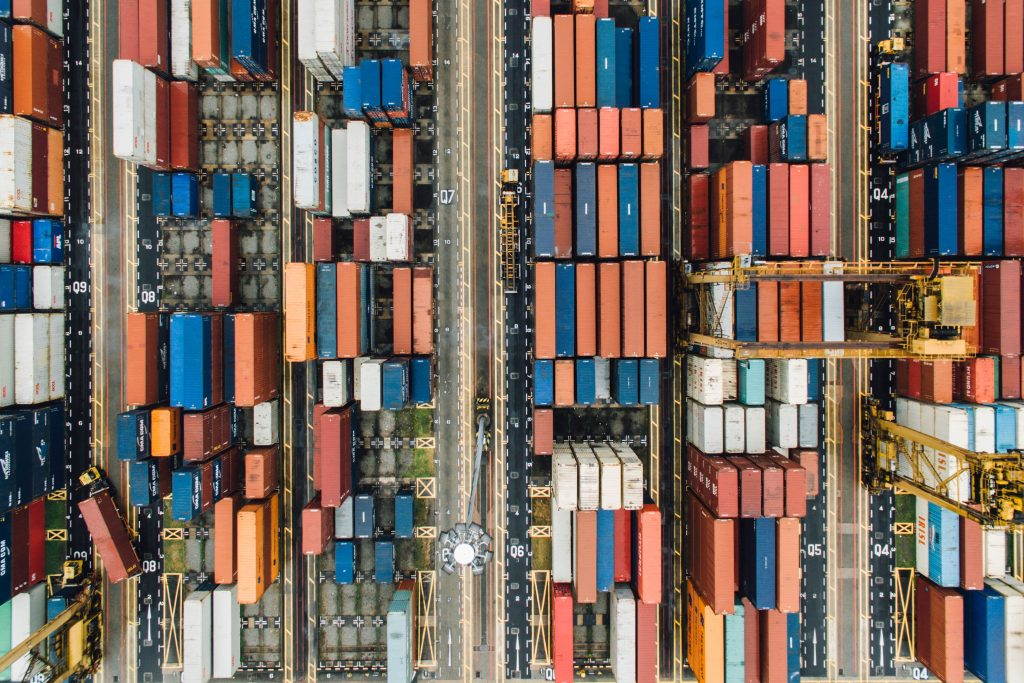 Birds eye view of colorful container yard managed by supply chain software