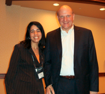 Silver Bullet employee named Lourdes with Microsoft executive Steve Ballmer receiving award for logistics software