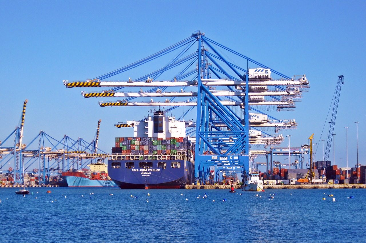 Ship at port operating as part of trading logistics systems